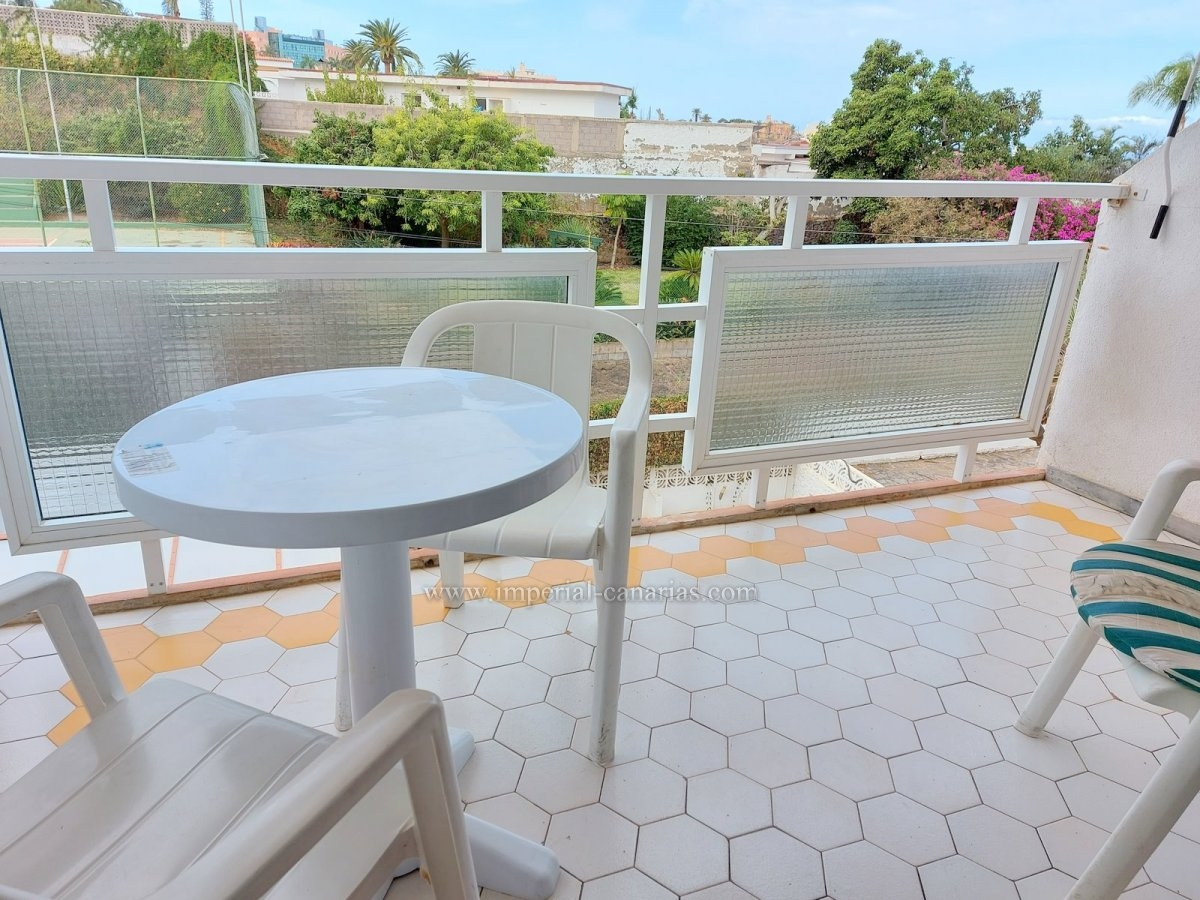 Cozy studio with balcony in a building with community pool and gardens